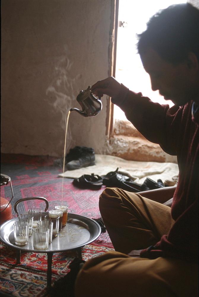 Western sahara. Man making tea in polisario smara camp.