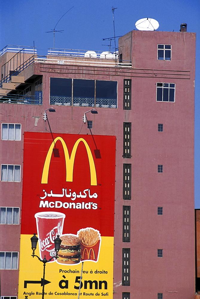 Consumerism, morocco. Marrakesh. Macdonalds and tv / satellite dishes