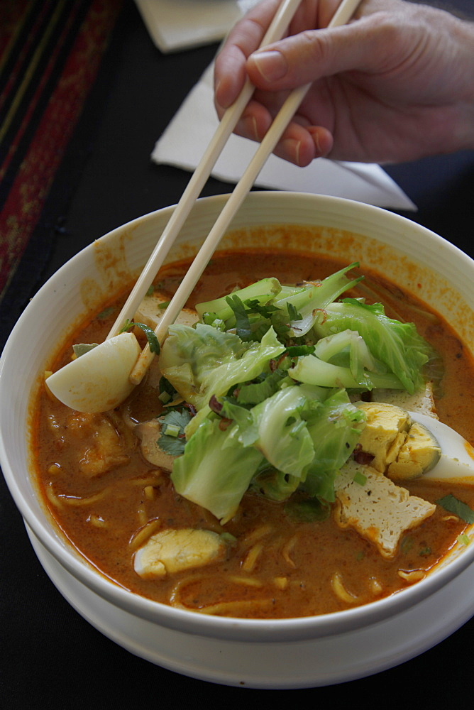 Traditional Laksa stew in a restaurant in Kuching, Borneo, Malaysia, Southeast Asia, Asia