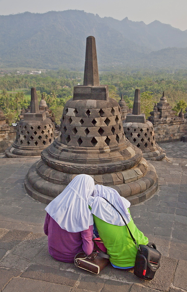 Local Muslim women visit the ancient Borobudur Buddhist Temple, UNESCO World Heritage Site, near Yogyakarta, Indonesia, Southeast Asia, Asia