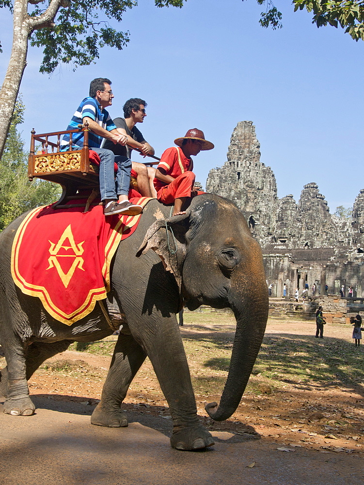 Tourists on elephants at the Angkor Wat Archaeological Park, UNESCO World Heritage Site, Siem Reap, Cambodia, Indochina, Southeast Asia, Asia
