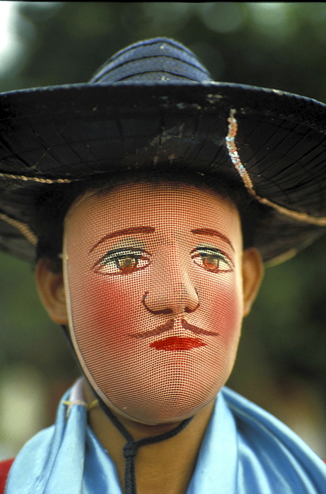 Traditional mask, nicaragua. Monimbo. A dancer wearing a traditional mask over their face