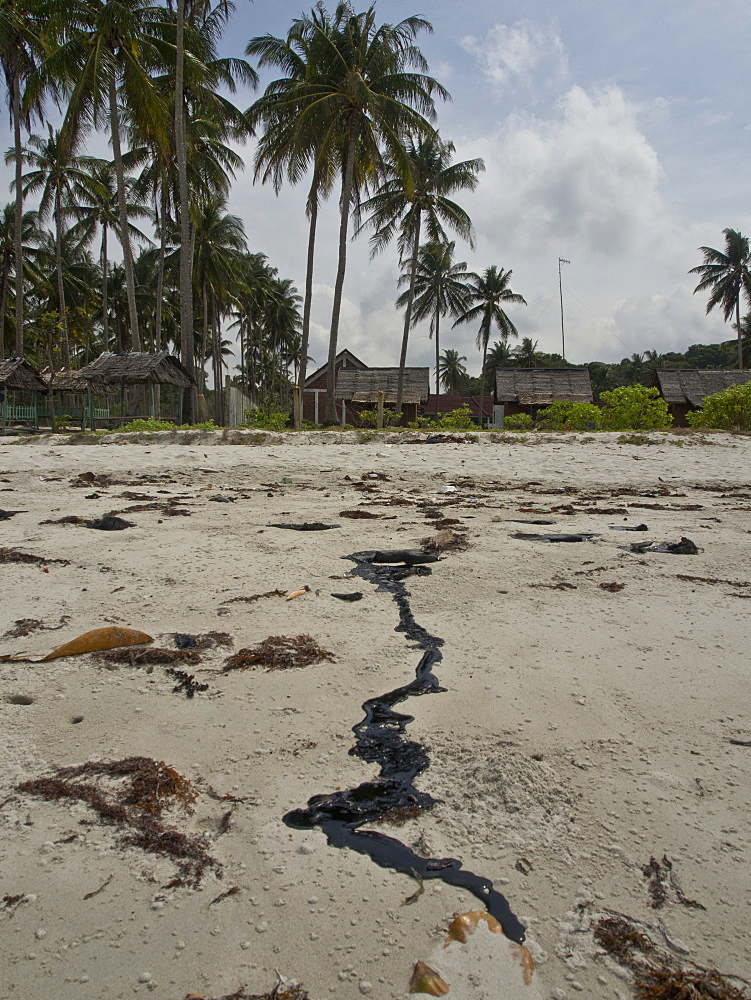 Tar pollution on beach due to oil spillages from shipping in Bintan Island, Sumatra, Indonesia, Southeast Asia, Asia