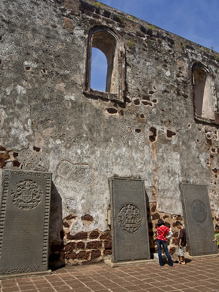 Tourists visit St. Paul's Hill with ruins of historical Portuguese fortress in Melaka (Malacca), UNESCO World Heritage Site, Malaysia, Southeast Asia, Asia