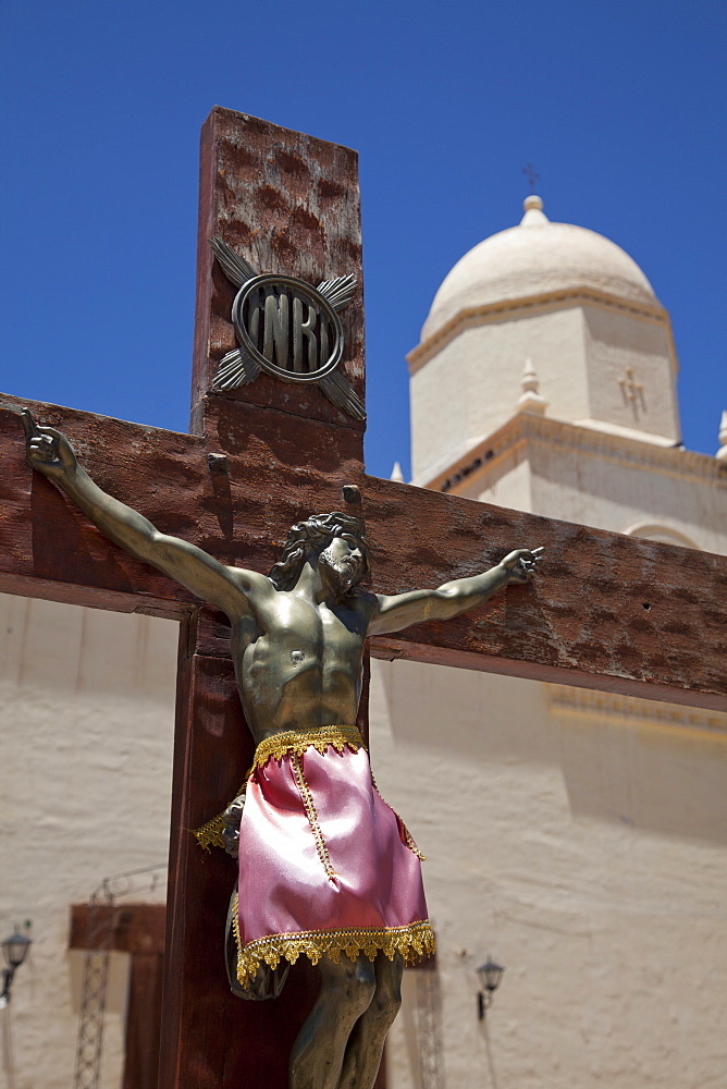 Traditional colonial church and crucifix in Humahuaca in Jujuy province in the Andes region of Argentina, South America