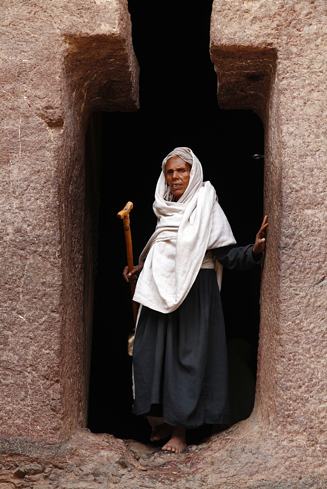 Pilgrim during the Easter Orthodox Christian religious celebrations in the ancient rock-hewn churches of Lalibela, Ethiopia, Africa - 1188-810