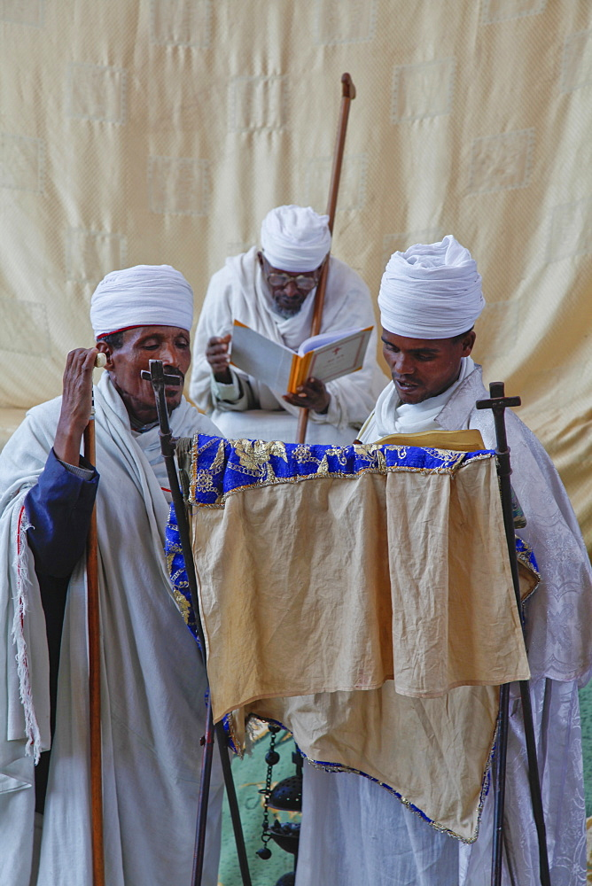 Priests singing during service at Easter Orthodox Christian religious celebrations in Lalibela, Ethiopia, Africa