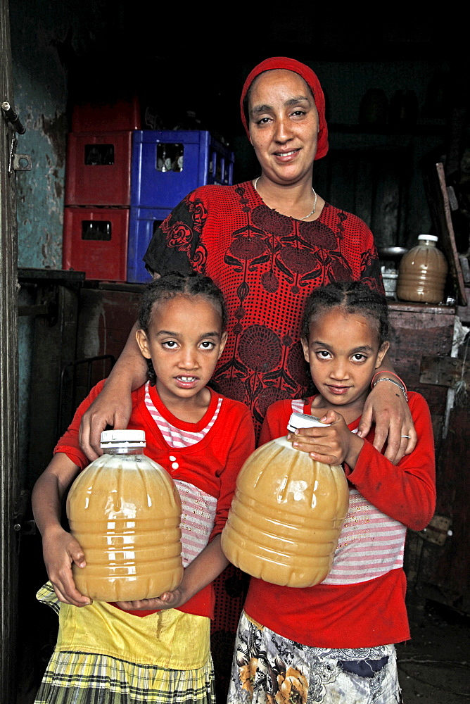 Farmer woman and family with honey produced in a co-operative in the Masha area of Ethiopia, Africa