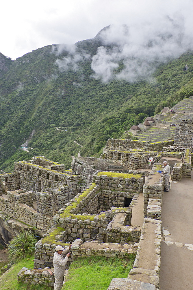 Restoration work at the Inca ruins of Machu Picchu, UNESCO World Heritage Site, Peru, South America - 1188-870