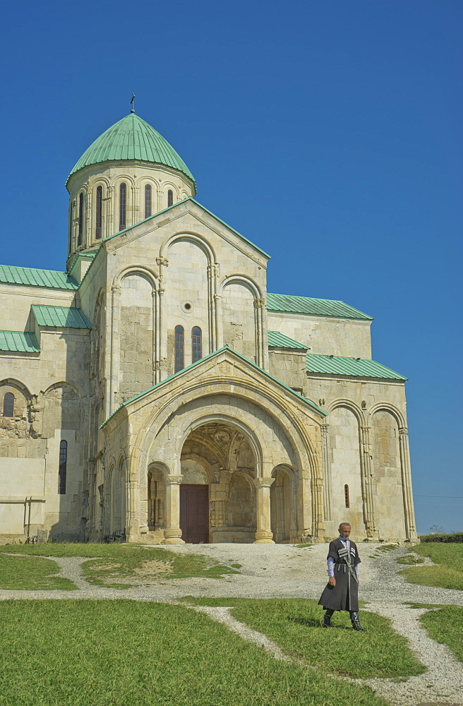 Priest walking by exterior of Bagrati Christian Orthodox Cathedral, UNESCO World Heritage Site, Kutaisi, Georgia, Central Asia, Asia - 1188-932