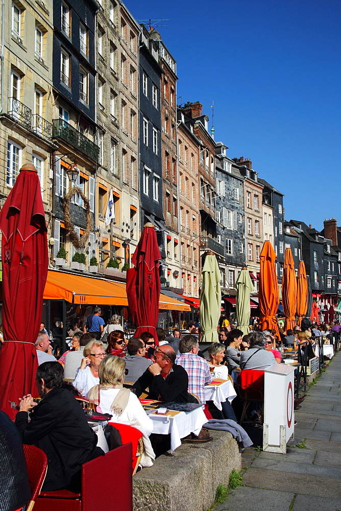 Diners lunching in restaurants at water's edge, Vieux Bassin, Old Port, Honfleur, Normandy, France, Europe