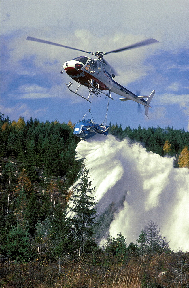 Acid rain, sweden. A helicopter is used for liming wetlands, lakes and streams against acid rain