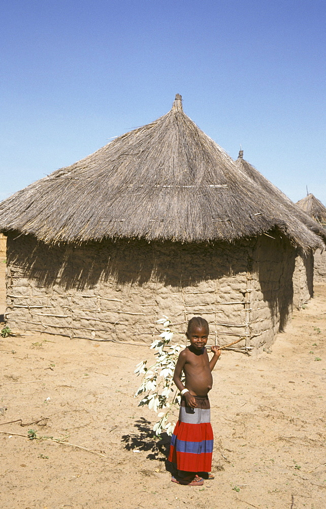 Zambia girl in front of her house, shangombo
