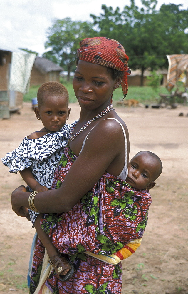 Benin woman and babies hangar village, bembereke