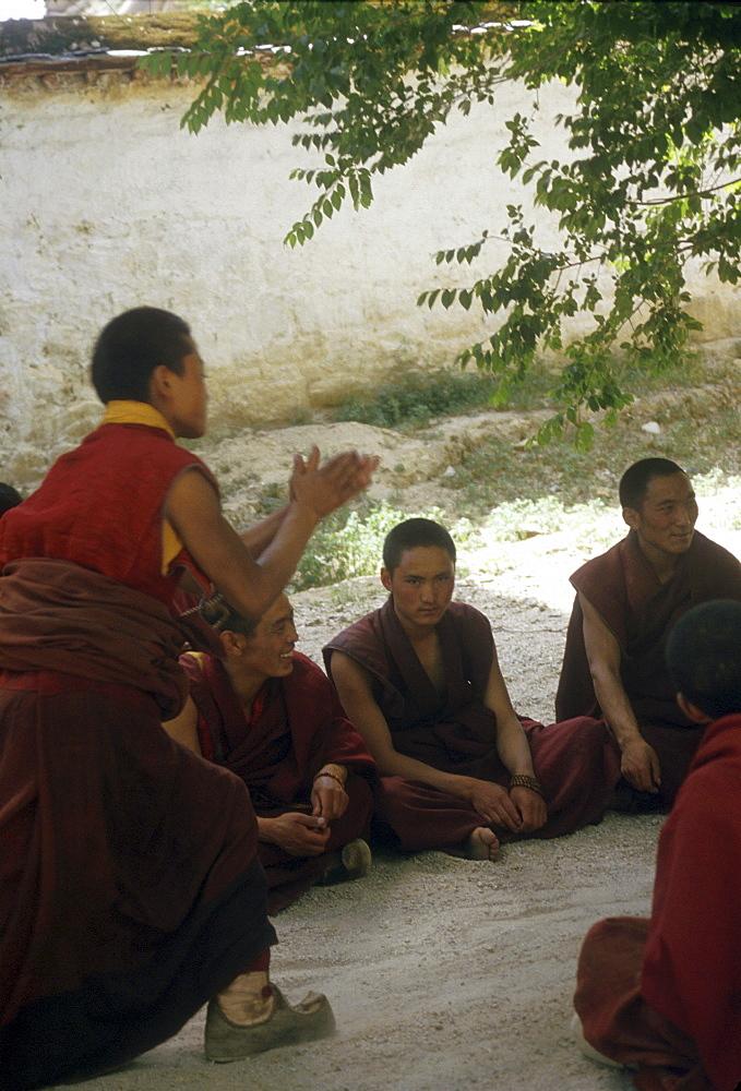 Novice monks practising theological debate monastery