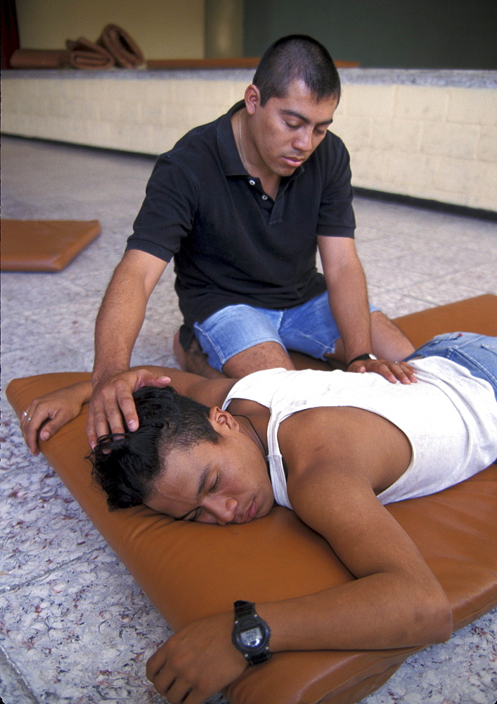 El salvador youth - theatre group, learning massage technique to sufferers, san salvador.
