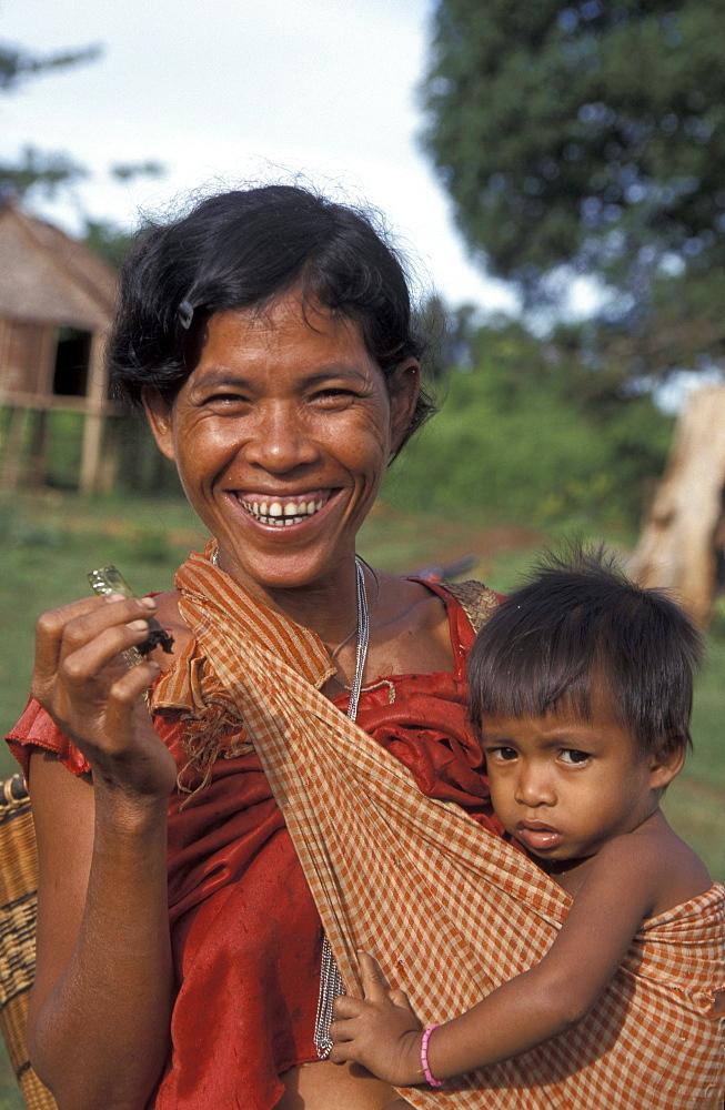 Cambodia kreung tribal woman and child, malik village, ratanakiri