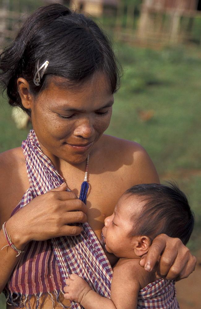Cambodia kreung mother breastfeeding her child, malik village, ratanakiri