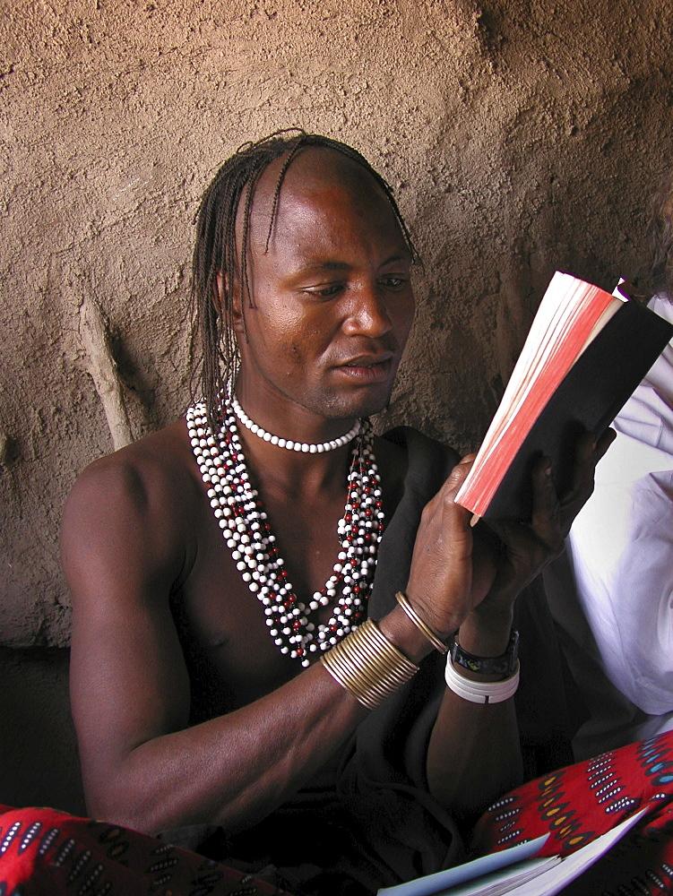 Watatulu tribals at catholic mass in a hut, tanzania. Mwankale