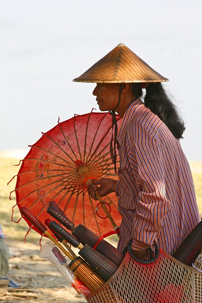 Myanmar woman selling umbrella/sunshades, mingun, near mandalay