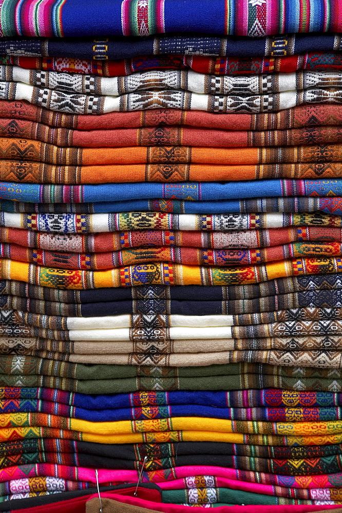 Bolivia. Pile of weavings at a shop of la paz