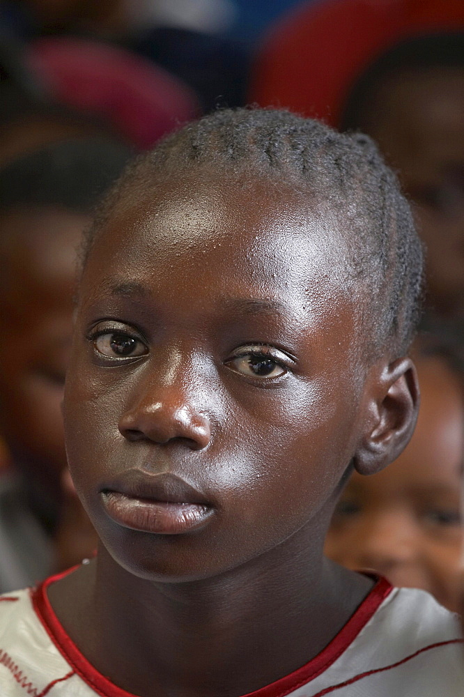 Kenya. Faces of the congregation at catholic mass in mukuru ruben, a slum of nairobi