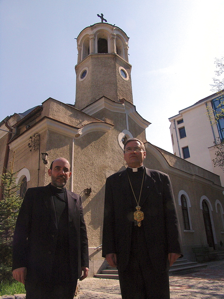 Religion, bulgaria. Bishop christo proykov (right) standing with father blagovast, standing in front of the assumption church, sofia. They are byzantine catholics