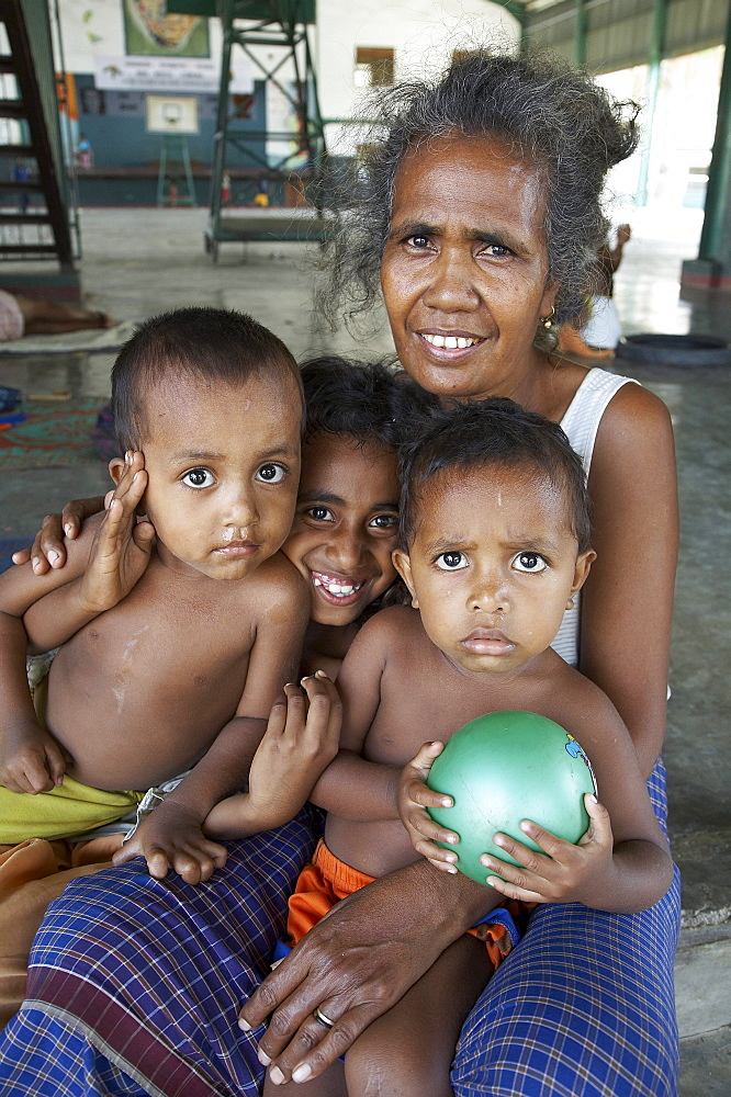 East timor. Camp for internally displaced people (idps) at the don bosco center in dili. Woman with her children