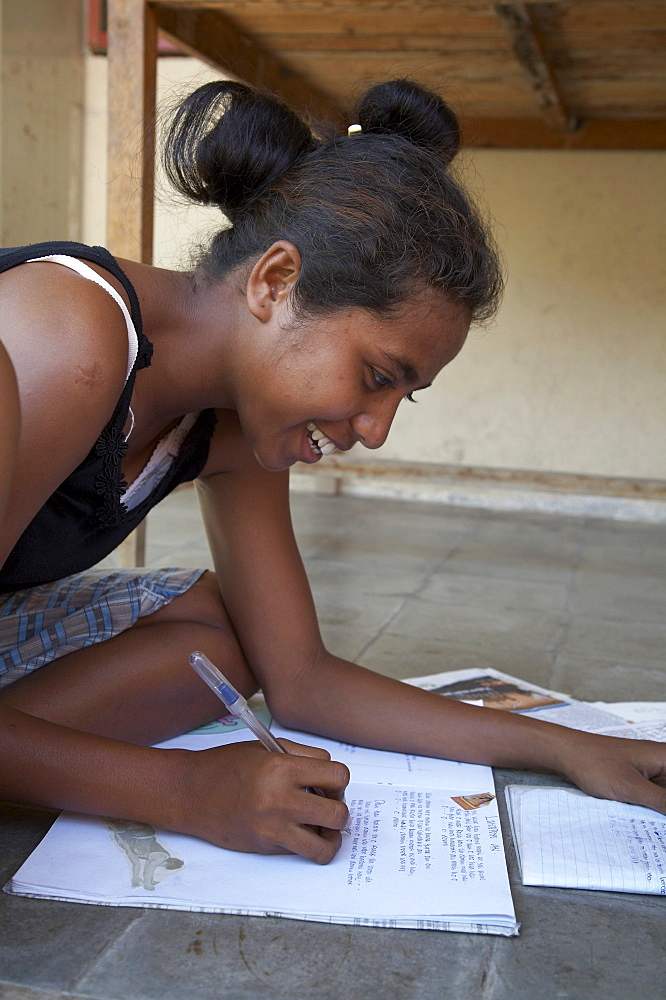 East timor. Girl studying, topu honis orphanage and childrens home, oecussi-amben