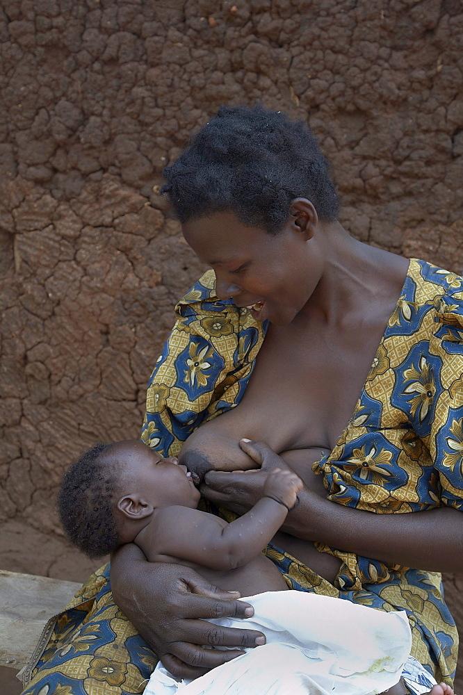 Uganda at the home of nakabugo betty, kisoga village, kayunga district. breast feeding her baby. kayunga district