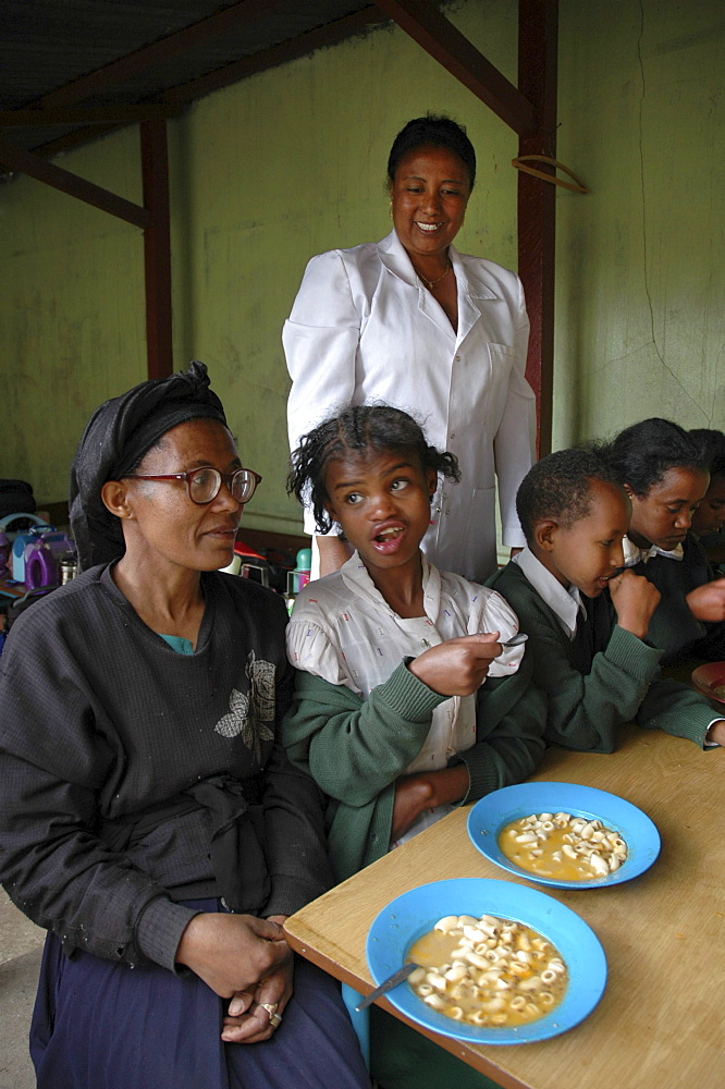 Food, ethiopia. Saint mary's catholic school, addis ababa. A mainstream elementary and secondary school, it has a small wing for special needs children, which is featured here. Betty and her mother feleku (on left) who helps with preparing food at the center. Other parents participate in rotation