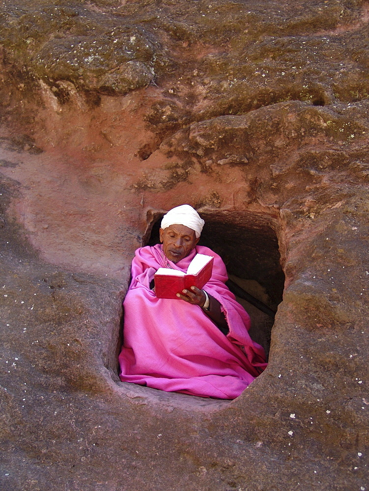 Religion, ethiopia. Monk (in pink, abba gebra kidan) staying in the caves near the churches of lalibela