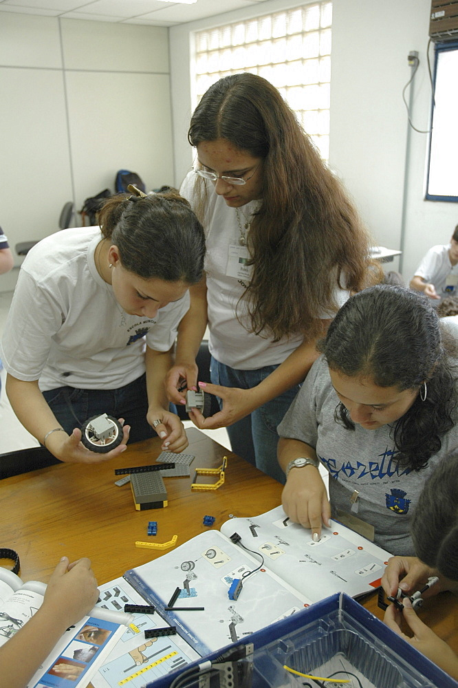 Education, brazil. Teenagers learning the basics of robotics at a course for poor in petropolis