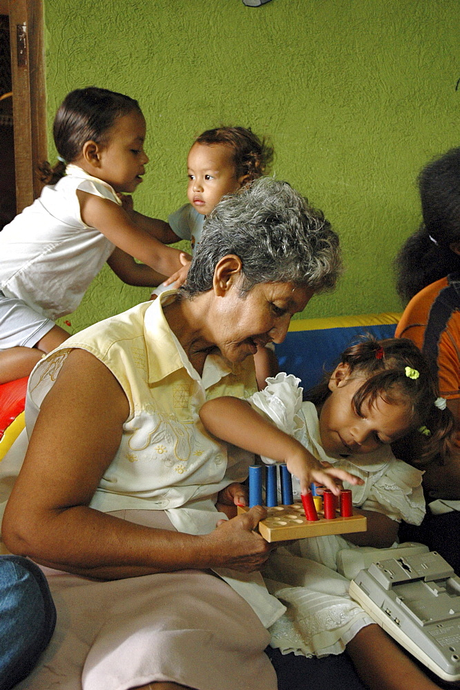 Colombia grandmother and child at a day care and child stimulation center run by dni (international defence of children) in barrancabermeja