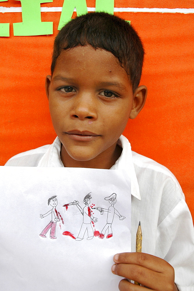 Colombia schoolboy showing his art depicting violence which he had witnessed at barrancabermeja, one of the most dangerous cities in the country