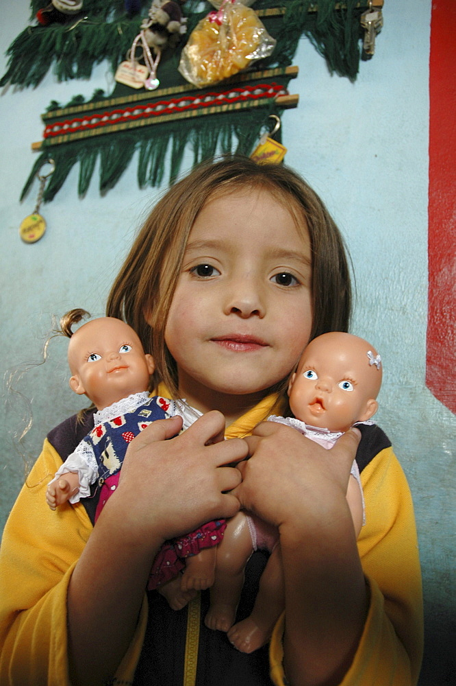 Colombia girl with her dolls. Altos de cazuca, bogota