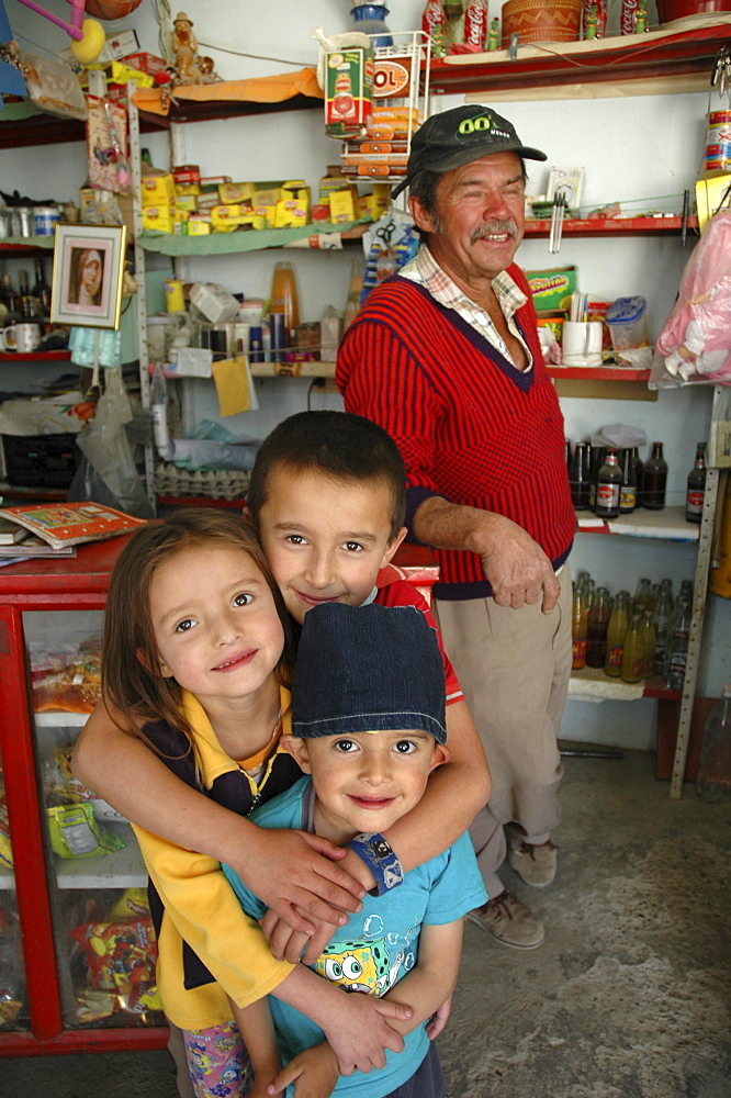 Colombia children with grandfather and his shop, altos de cazuca, bogota