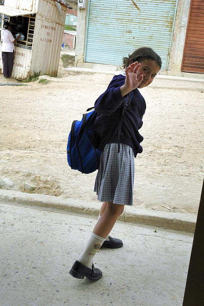 Colombia marly juliet, 7, of the slum of altos de cazuca, bogota, heading off to school