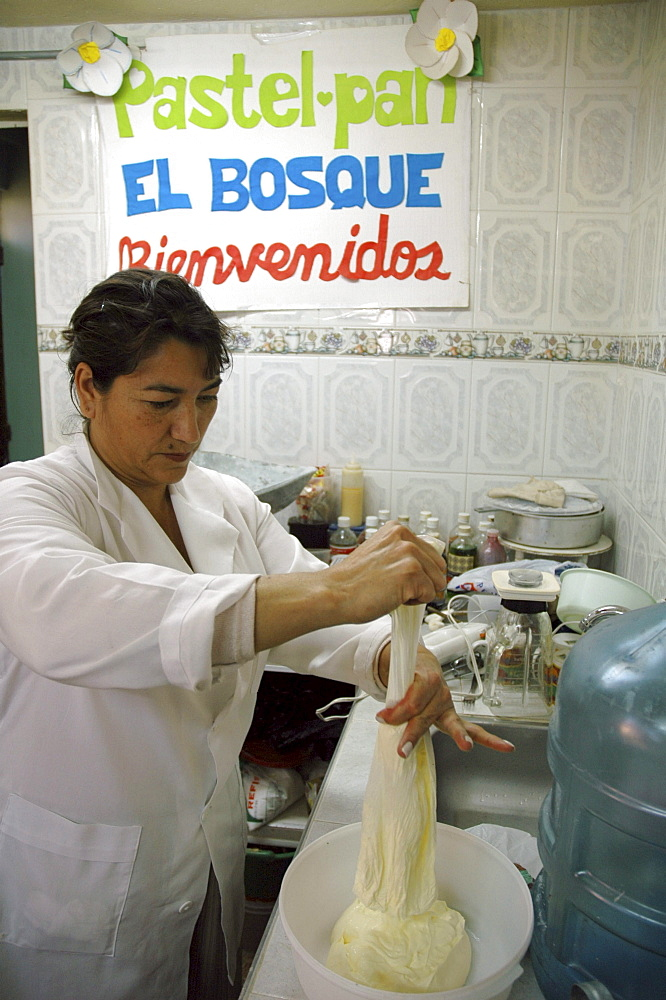 Colombia woman preparing dough for making bread at a bakery in ciudad bolivar, bogota