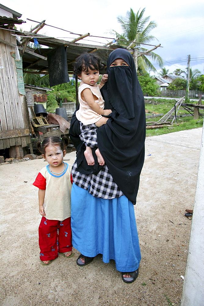 Thailand muslim woman with her children, pattani