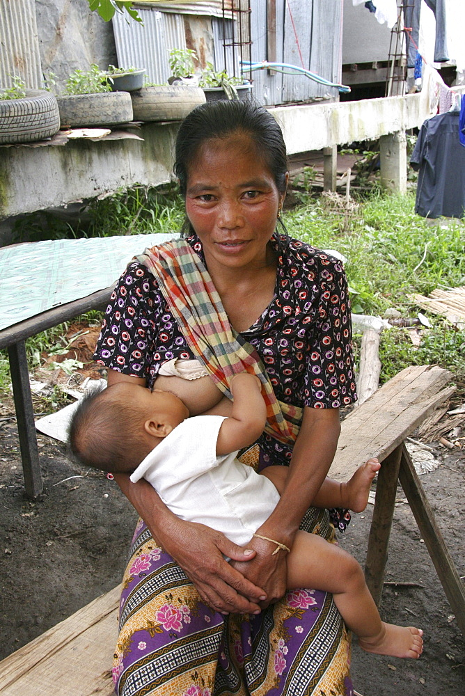 Thailand mother breast feeding baby. Inhabitants of a slum in chiang mai