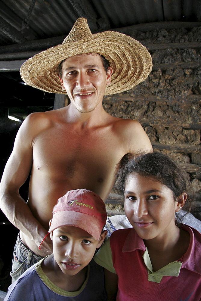 Venezuela man and children, el castano, a remote village in the hills near barquisimeto, lara state