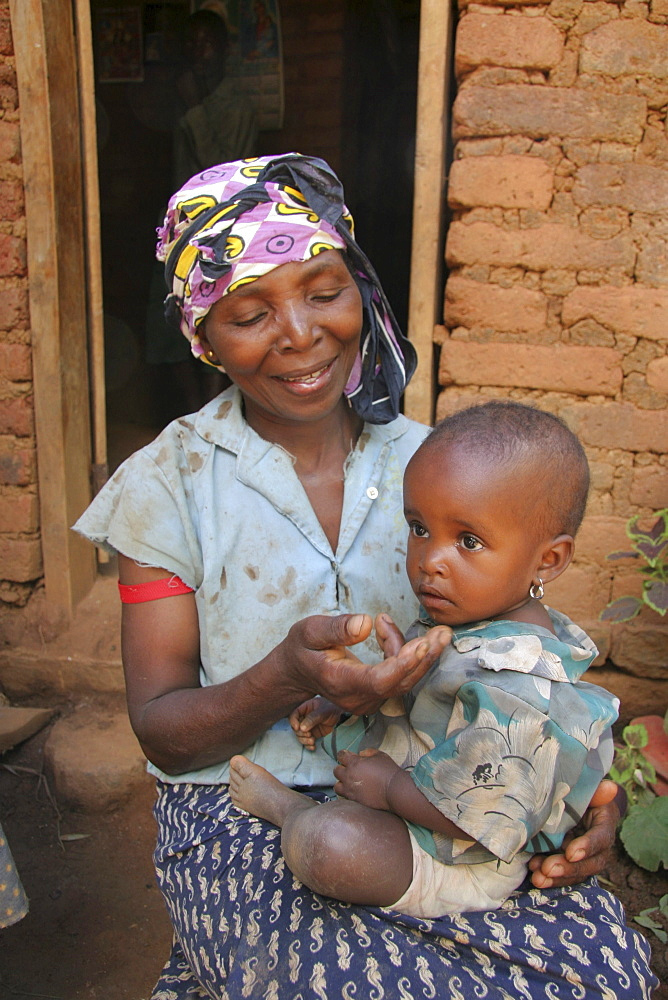Tanzanian woman with grandchild. Kighare, same, in the north-east near kilimanjaro