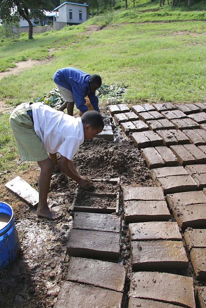 Tanzanian school boys making mud bricks. Kisangara, same, in the north-east near kilimanjaro