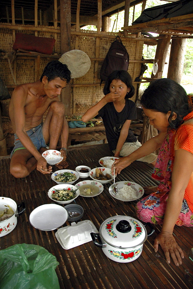Cambodia family eating meal, kampong cham