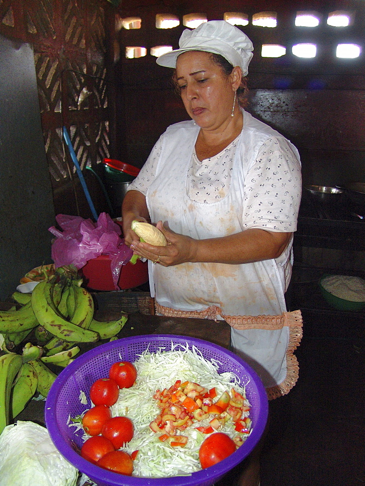 Nicaragua woman preparing food in her small local restaurant, managua