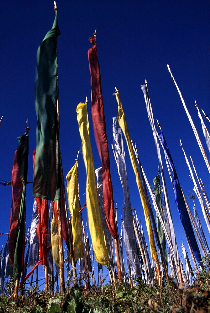 Bhutan. Prayer flags. supreme guru is someone is drunk with experience of three higher trainings. qualified is someone confidence, energy, intelligence compassion, is mindful of shortcomings of worldly life transcended wordly concerns. -vajra verses of whispered tradition by indian mahasiddha naropa