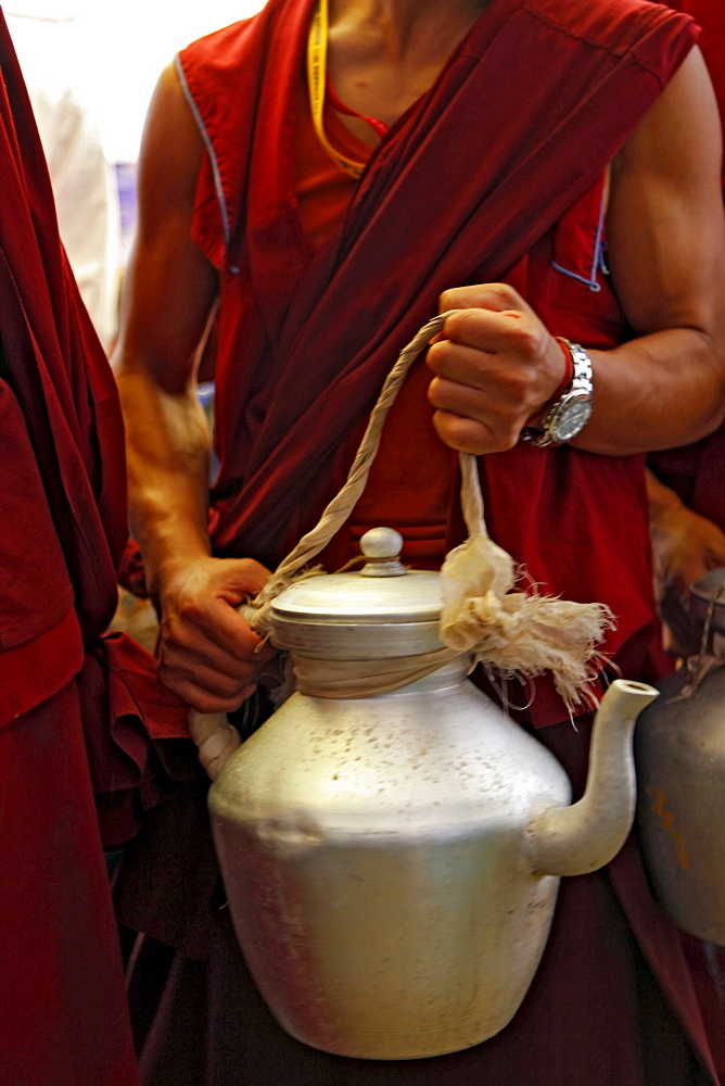 Volunteer monks distribute tibetan butter salt milk tea to the kalachakra initiation attendants. Kalachakra initiation in bodhgaya, india