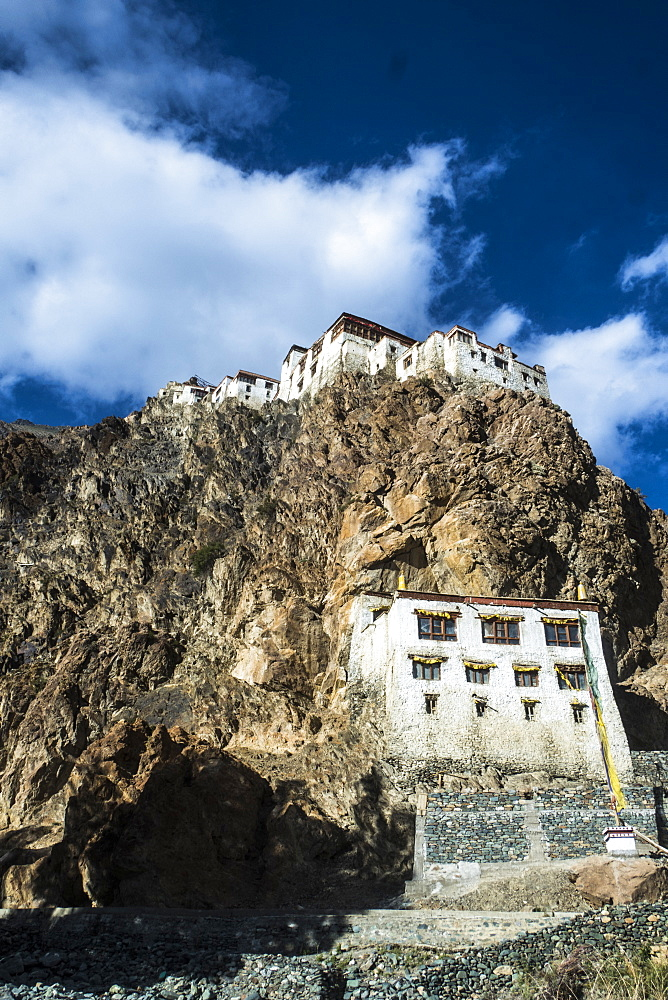 View of Kharsha Monastery from uphill walkway to Kachod Drub Ling Nunnery. Roughly one - hundred monks reside in Kharsha and they follow the Gelugpa order. It is the largest monastery in the Zanskar region. Top of the monastery serves the beautiful view o - 1196-336