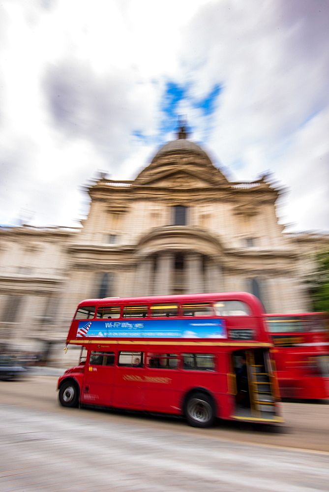 London bus going past St. Pauls Cathedral, City of London, London, England, United Kingdom, Europe